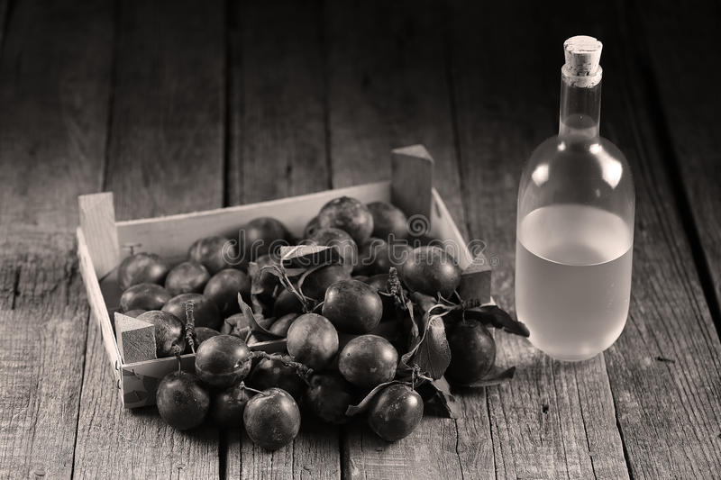 Plum brandy, Romanian tuica stock photography