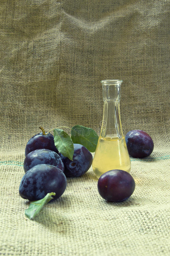 Plum brandy or schnapps and tasty plum fruit. royalty free stock photo