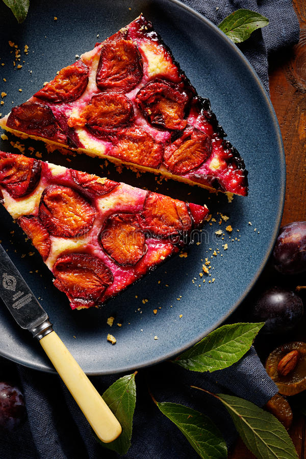 Plum cake on a plate royalty free stock image