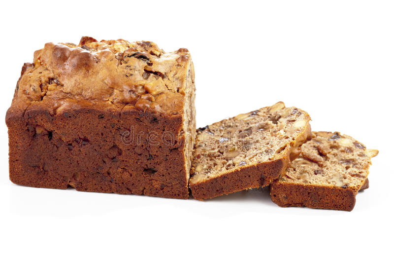 plum-cake tradizionale su fondo bianco immagini stock