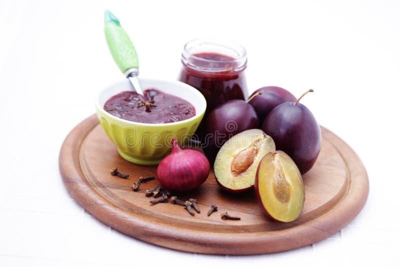 Plum chutney. Homemade plum chutney - goods in jar royalty free stock images