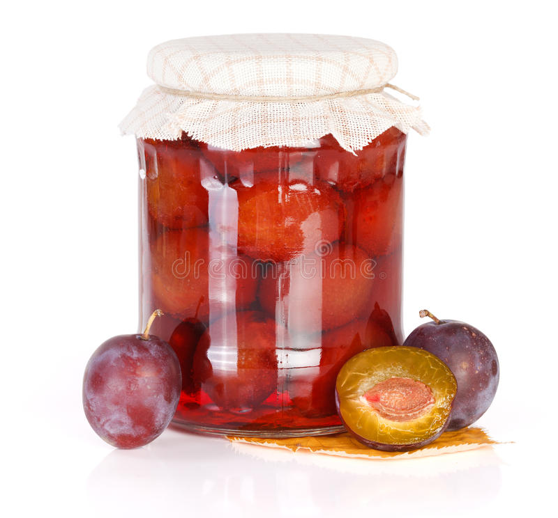Plum compote. With fresh plums on white background stock images