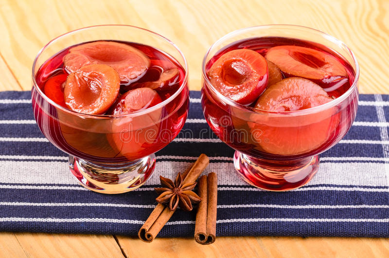 Plum compote. In the glass bowls stock photo