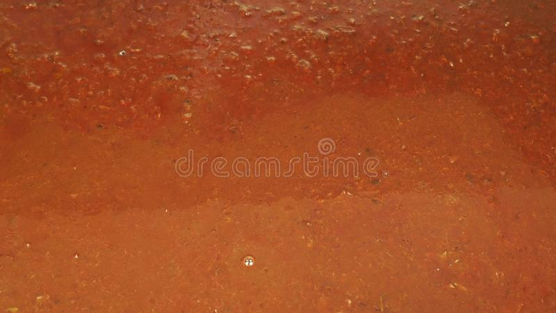 Plum ferment and fermentation barrel yeast into the tub leading to the boiler, making domestic plum alcohol, liquor. Pouring barrel plum ferment and fermentation royalty free stock image