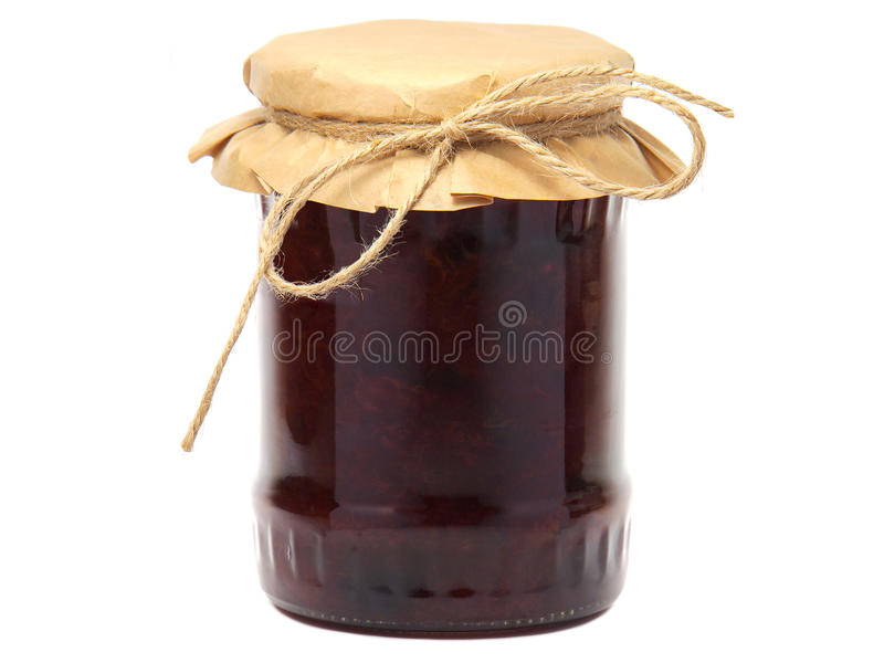 Plum jam in a glass jar. Isolated on white background stock images