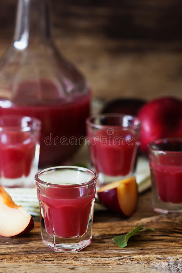 Plum liqueur in a glass. Traditional homemade plum liqueur. Alcoholic drinks. Selective focus stock image