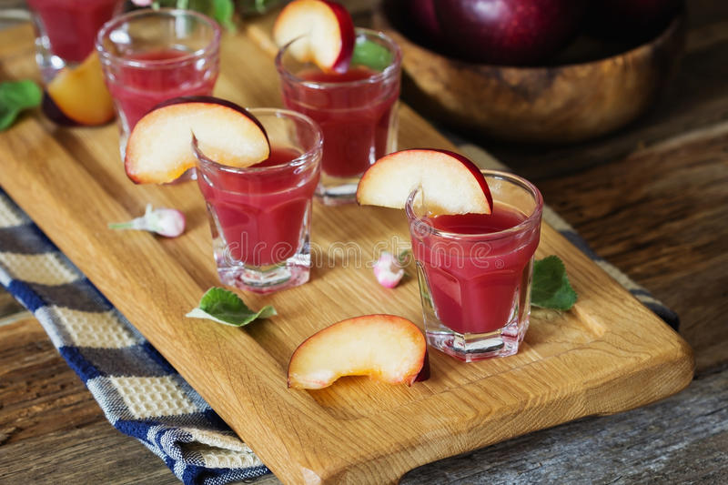 Plum liqueur in a glass. Traditional homemade plum liqueur. Alcoholic drinks. Selective focus royalty free stock photography
