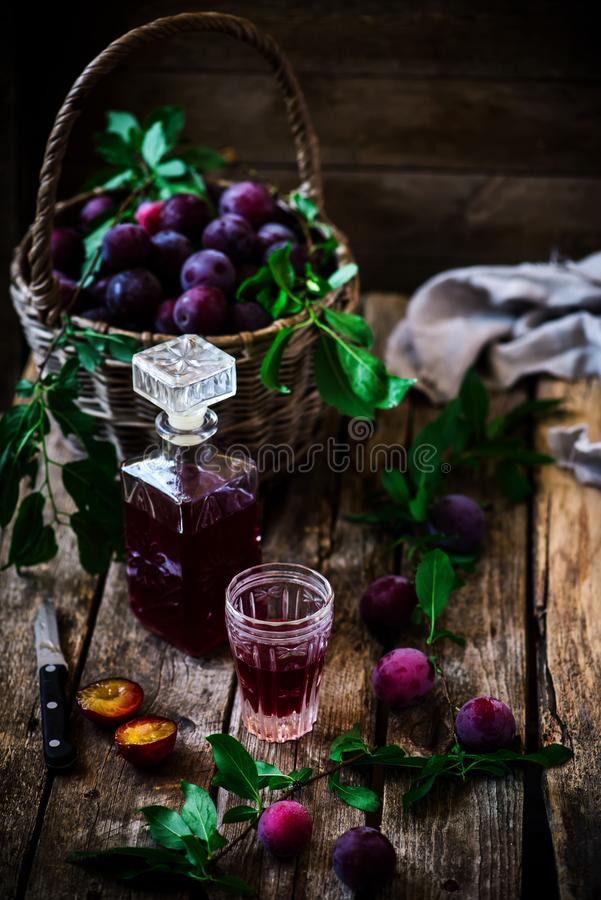 Plum liqueur.style vintage. selective focus royalty free stock photography