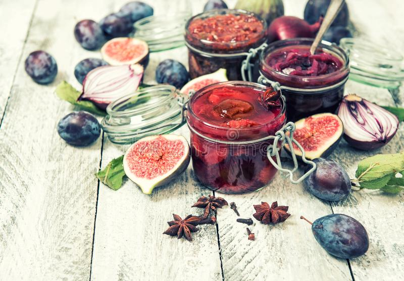 Plum marmalade fig jam red onion confiture vintage. Plum marmalade, fig jam, red onion confiture. Food background vintage toned stock photo