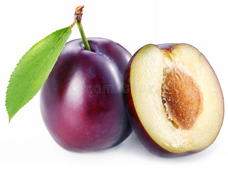 Plum with a slice and leaf stock photos