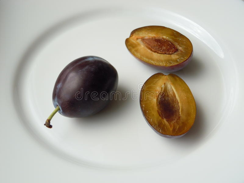 Plum with a slice royalty free stock images
