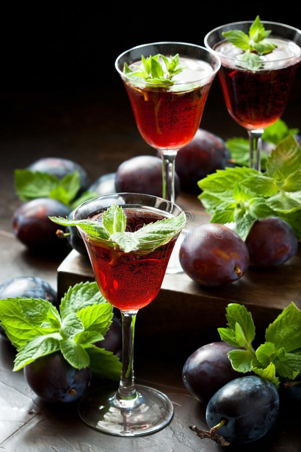 Glasses of fruit  liqueur on dark background stock photography