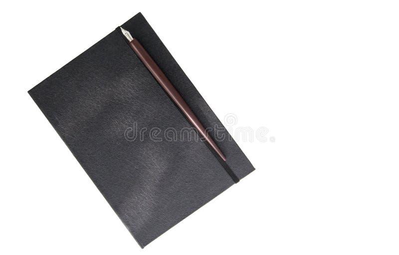 Pluma del libro y de la semilla imagen de archivo