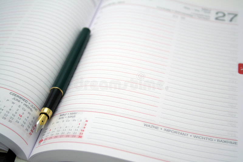 Download Pluma en el calendario foto de archivo. Imagen de plan - 1284896