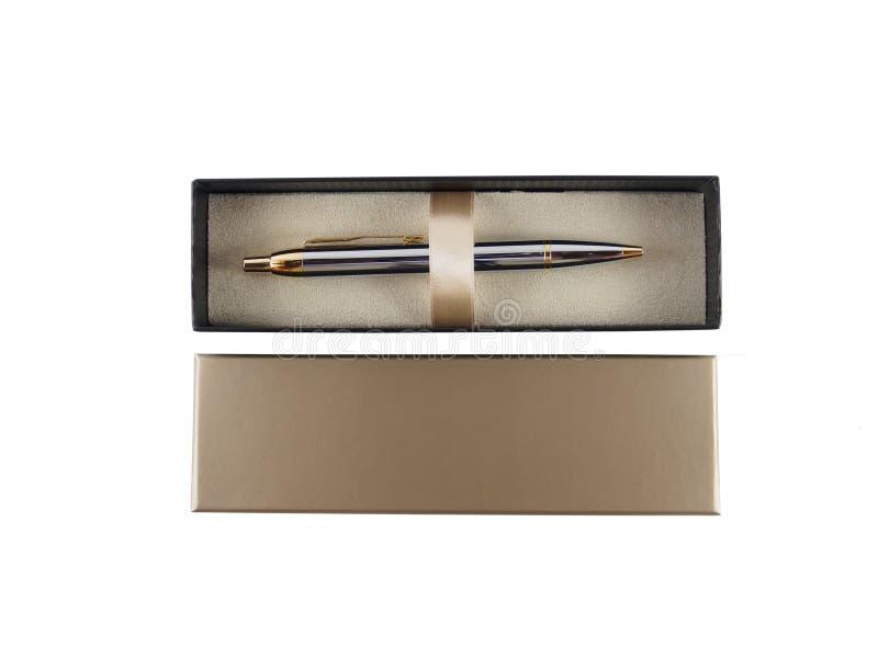 Pluma en la opinión superior de la caja del fondo blanco fotografía de archivo libre de regalías