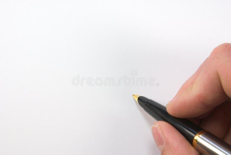 Pluma sobre el papel en blanco imagen de archivo