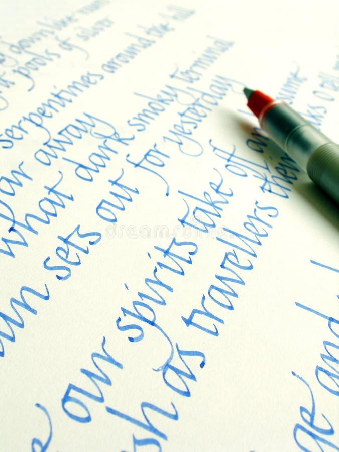 Pluma y escritura de la caligrafía imagen de archivo libre de regalías