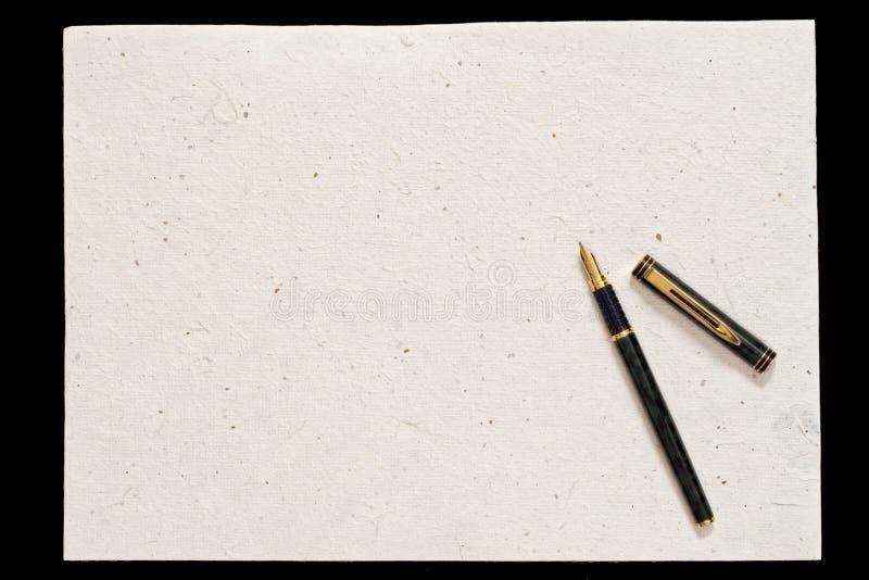 Pluma y papel viejo foto de archivo libre de regalías