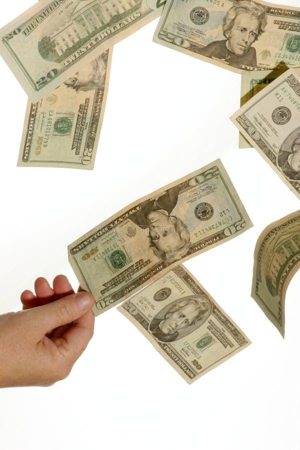 Plumaison de l'argent comptant photos libres de droits