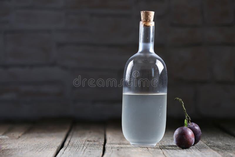 Plumb brandy, Romanian tuica royalty free stock image