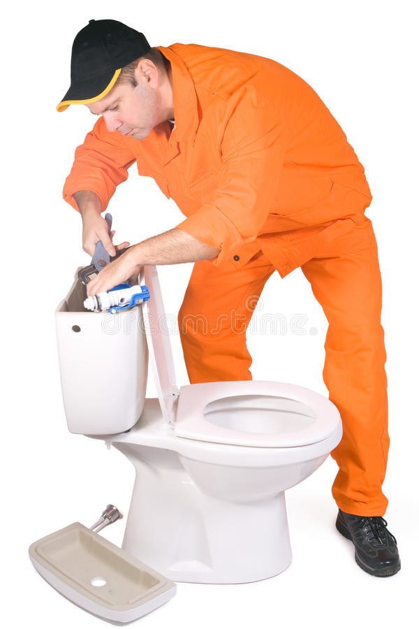 Plumber. Mounted toilet bowl on white background royalty free stock images