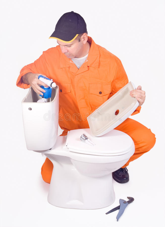 Plumber. Mounted toilet bowl isolated on background royalty free stock photos