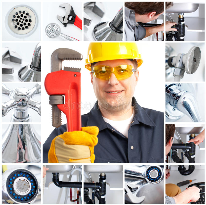 Plumber. Smiling handsome plumber with an adjustable wrench stock images