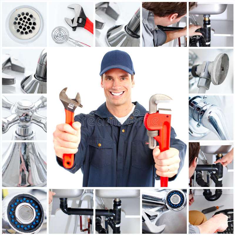 Plumber. Smiling handsome plumber with an adjustable wrench royalty free stock photos