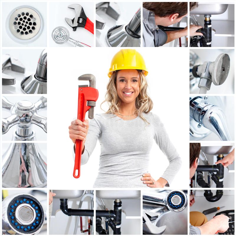 Plumber. Smiling plumber woman with an adjustable wrench stock photo