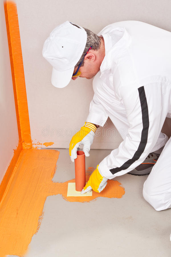 Download Plumber Apply Waterproofing Cuff Stock Photo - Image: 27136536