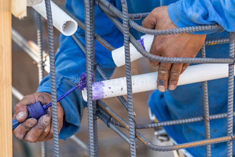 Plumber Applying Pipe Cleaner, Primer and Glue to PVC Pipe stock photos