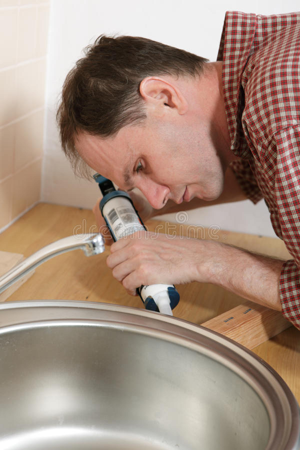 Plumber with caulking gun royalty free stock photo