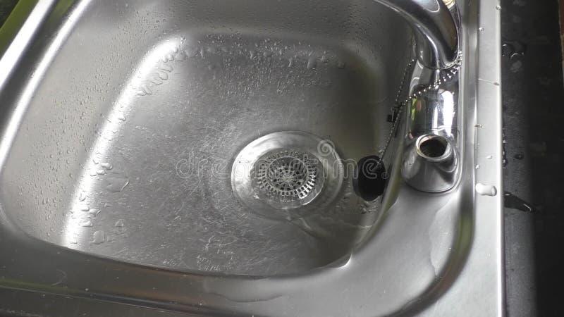 Plumber changing leaking kitchen sink tap valve.