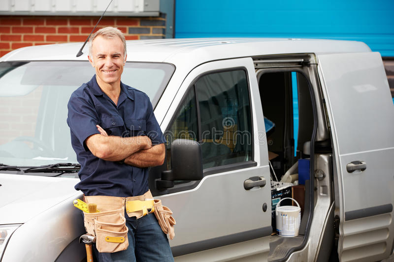 Plumber Or Electrician Standing Next To Van. With Arms Crossed Smiling stock photo