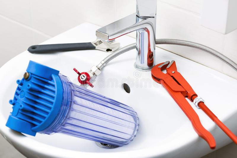 Plumber equipment and water filter in the sink royalty free stock images