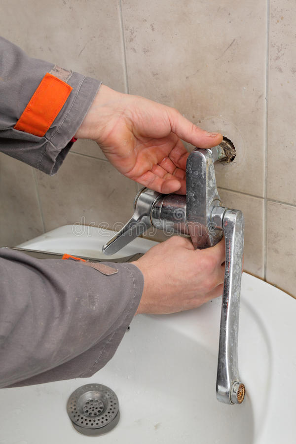 Plumber Fixing Faucet In A Bathroom Stock Photo - Image of collar ...