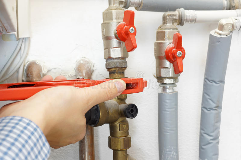 Plumber fixing pipe system royalty free stock photo