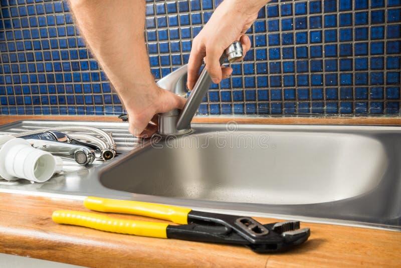 Plumber Fixing Tap stock photo. Image of serviceman, plumbing - 55845832