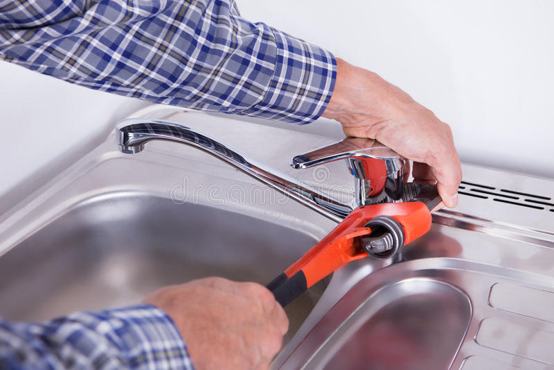 Plumber fixing washbasin royalty free stock images