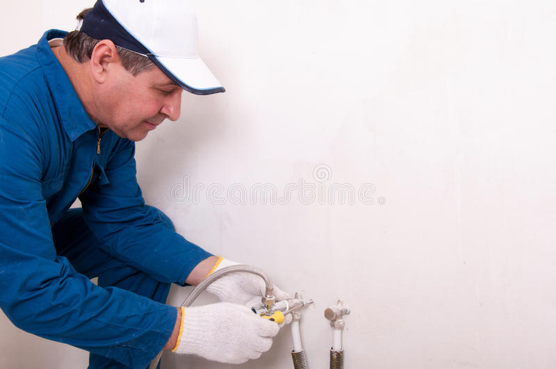 Plumber fixing water pipe. Picture of plumber fixing water pipe stock photos