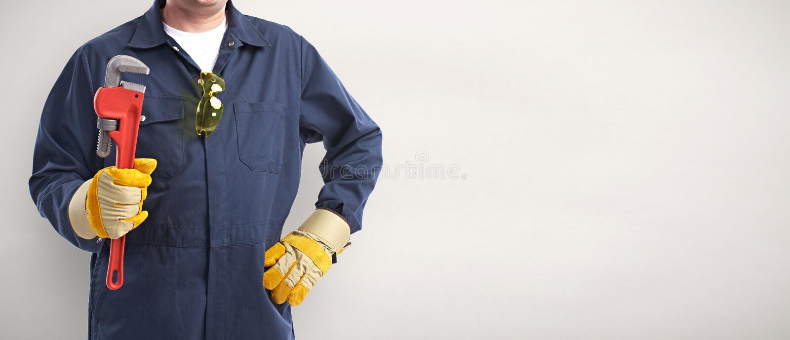 Plumber hand with wrench. stock image