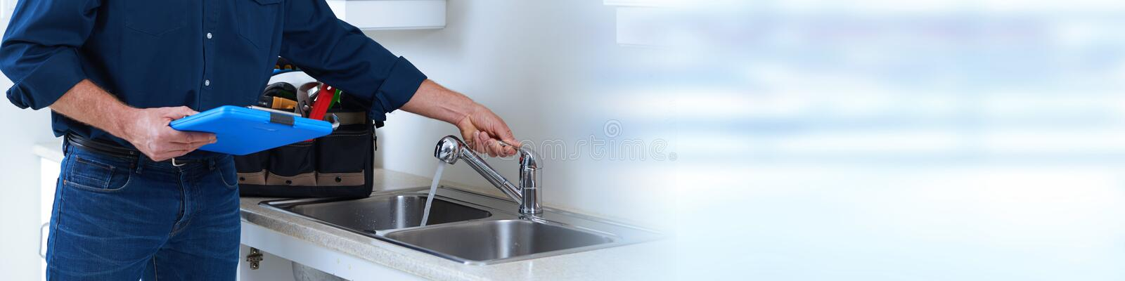 Plumber hands with clipboard. Professional plumber doing renovation in kitchen home stock images