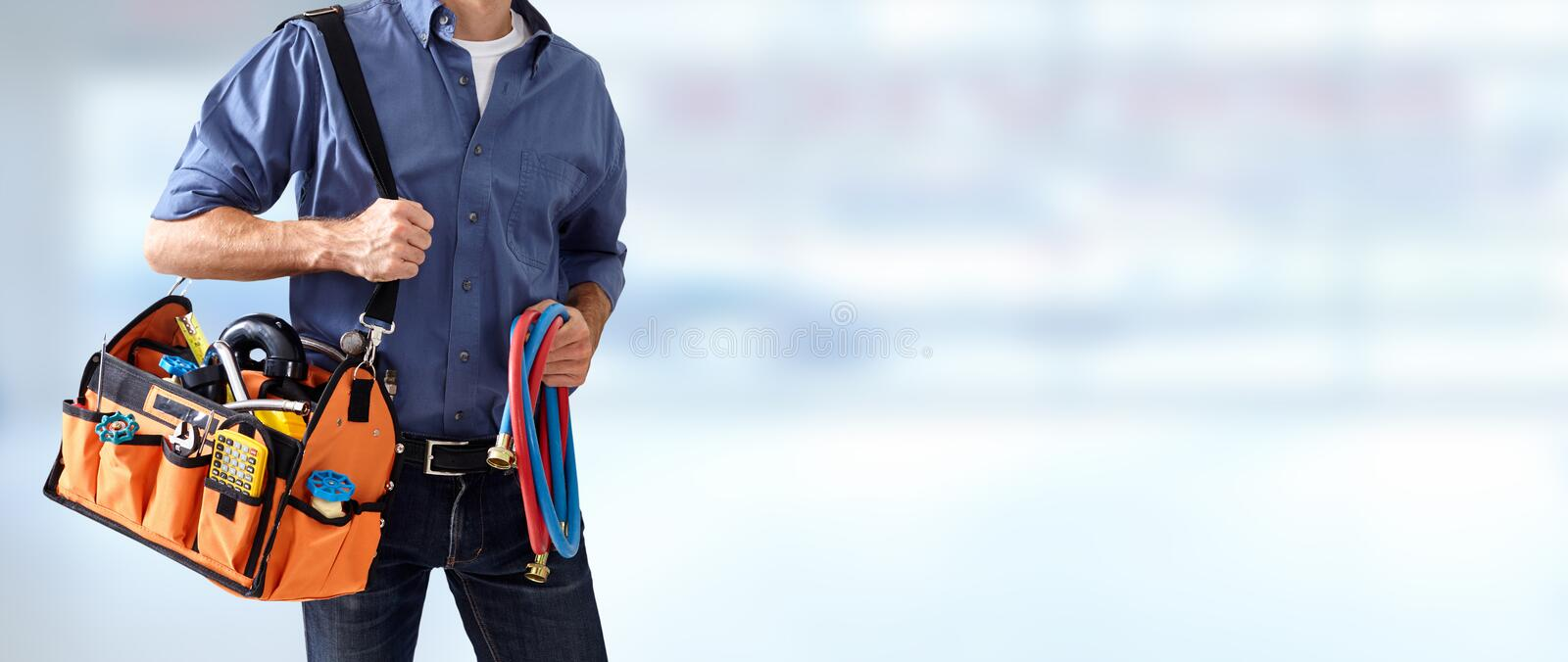 Plumber hands with tools. Professional plumber with tools over abstract background stock photos