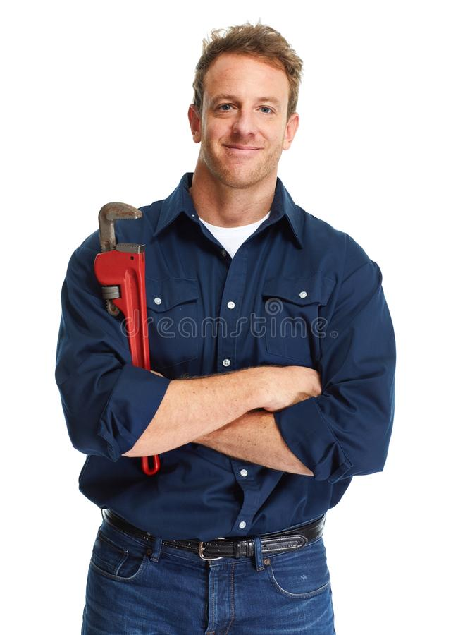 Plumber. Handsome plumber with wrench isolated white background stock image