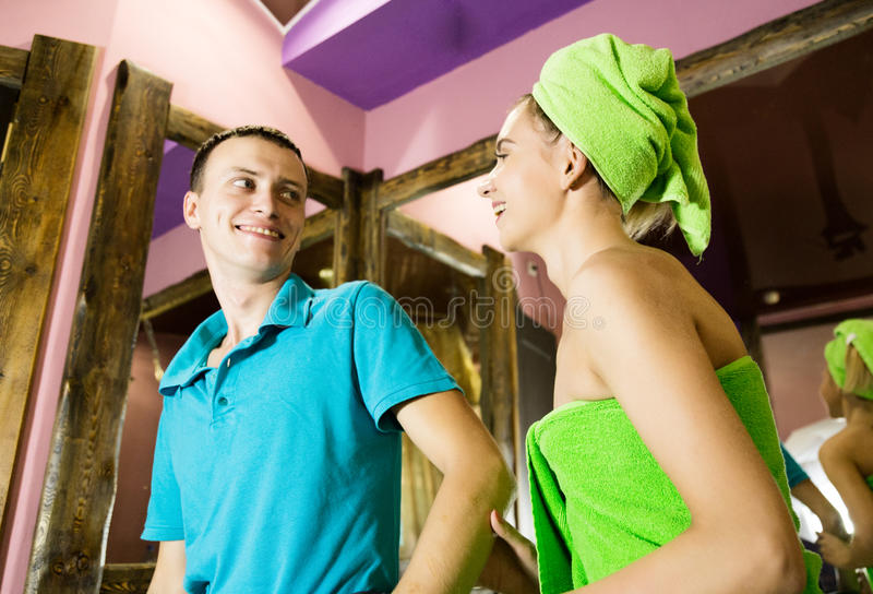 Plumber having flirt with young girl at home. men with young female customer before flirt royalty free stock images