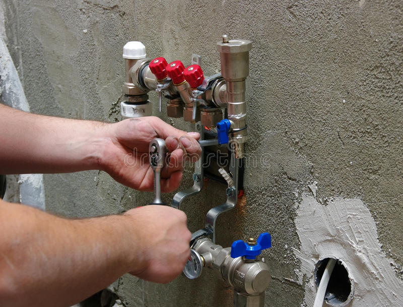 Download Plumber Installing Pipes Royalty Free Stock Photo - Image: 29438345