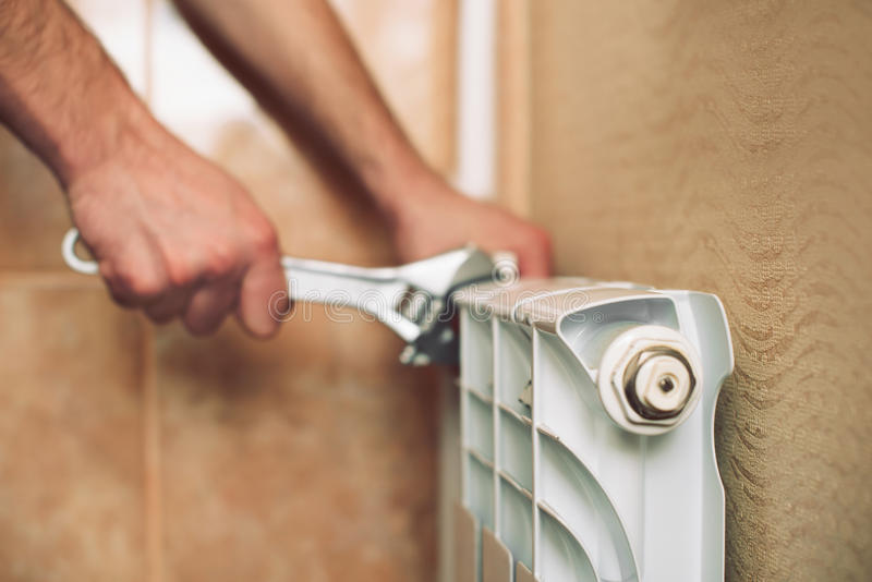 Plumber installs a heating system royalty free stock images