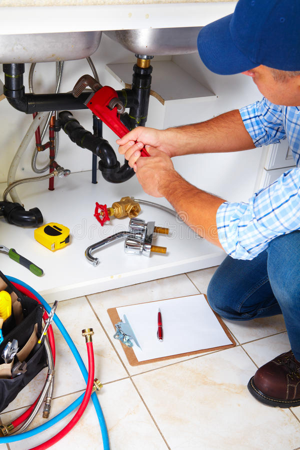 Free Plumber On The Kitchen. Royalty Free Stock Photography - 48565397