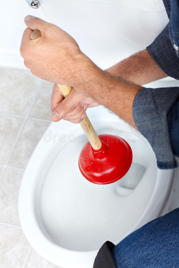 Plumber with a plunger. Plumber with a toilet plunger royalty free stock images
