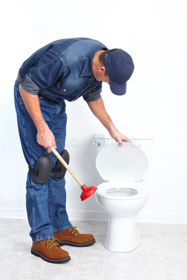 Download Plumber with a plunger stock photo. Image of plunger - 17312956